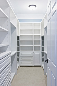 large white walk-in closet with shelves